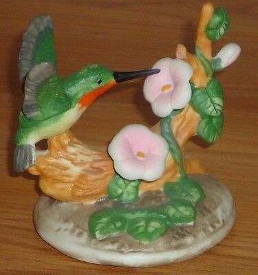 "Hummingbird 4"" porcelain  Figurine w/white & pink flowers"