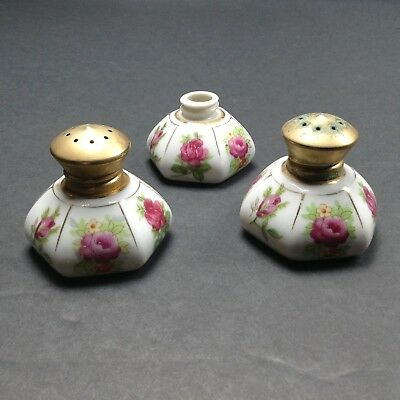 Pair of Irice Salt and Pepper Shakers plus one extra repaired