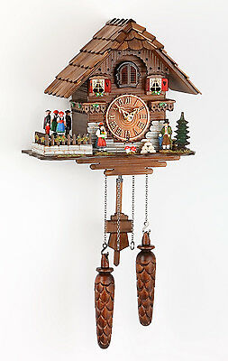German black forest hand carved cuckoo clock quartz movement and turning dancers