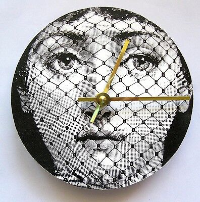 Fornasetti Lina Cavalieri face image made into a wall clock.  Woman with a veil.