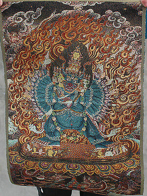 A golden silk embroidery thangka Tibet and Nepal exorcism peace and wealth