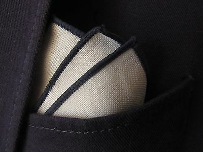 white cotton linen look pocket square handkerchief with navy trim. see photo