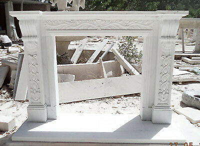 Classically Designed Marble Fireplace Mantel with Intricate Floral Ribbon Detail