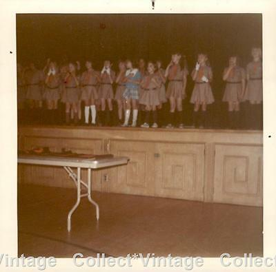 Large group of Girl Scouts standing on a stage - vintage found photo *208