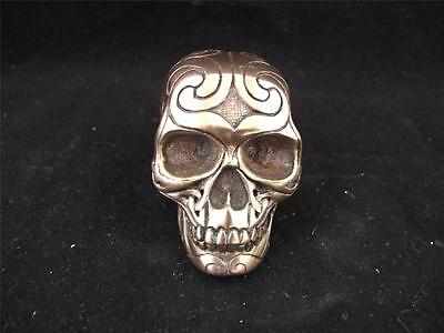 Resin Cast Small Tribal Skull with a Bronze Finish.