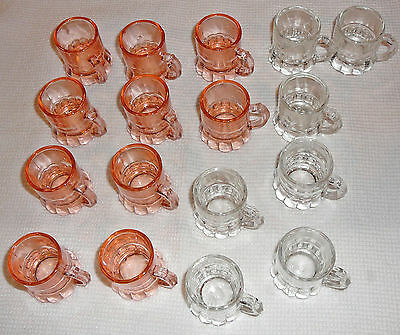 Vintage 1940s pink and white glass shot glasses with handle. 10 pink, 7 white