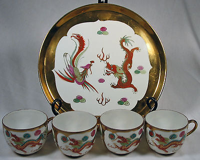 Asian Dragon Plate with four matching Dragon Teacups