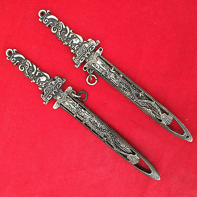 antique   In ancient China, a pair of brass hollow out sword with scabbard.