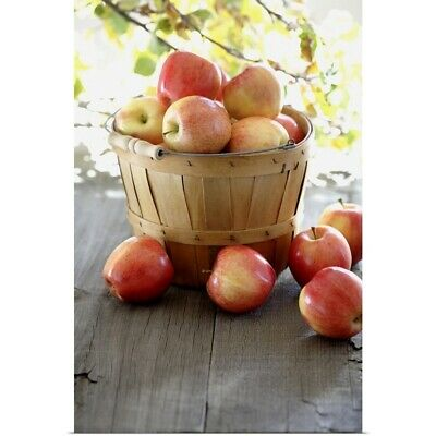 Poster Print Wall Art entitled Red apples overflowing basked