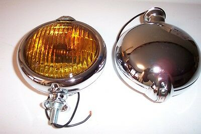 Five inch chrome fog lights with FOG script on the top and amber lenses, one pr.