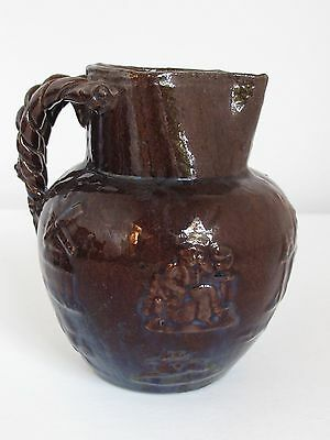 Antique  Glazed Redware Pitcher Various embossed Scenes Rope Handle