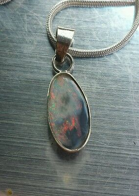 Handcrafted black opal pendant . 925 Stirling silver.  Solid opal