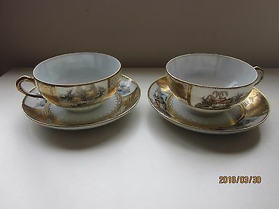 Two hand painted cups and saucers made in Japan