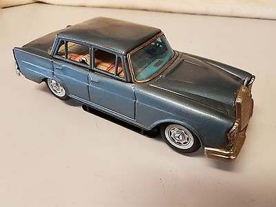 Antique 50 Year Old Classic Pressed Steel Battery operated Toy Mercedes Car