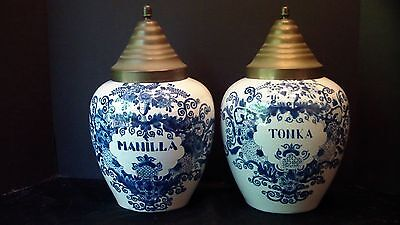 Two Dutch Delft Tobacco Jars With Scrolled Floral Designs