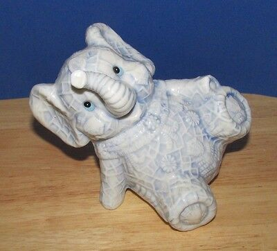 light blue white ceramic elephant seated playful bank embossed Asian Circus ?