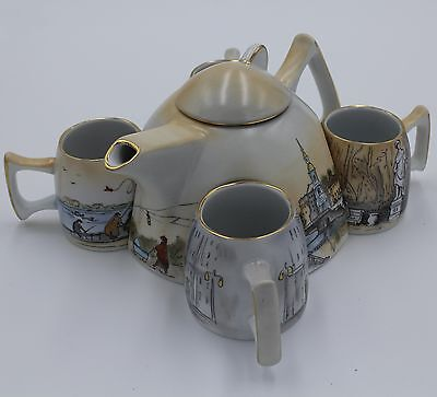 "New antique teapot and 4 cups from porcelain is painted in Russia ""Leningrad"""
