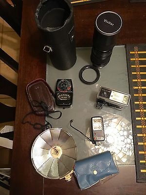 Lot of Camera items and accessories,lens, lens caps, flash attachments