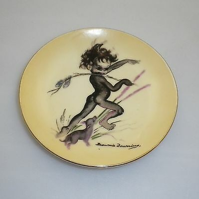 Brownie Downing 1950's pin dish of an Aboriginal Child playing with a puppy.
