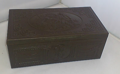 Antique metal box with detailed scene