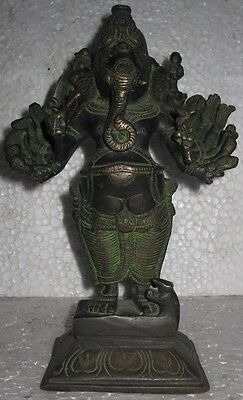 123 An old look solid brass standing GANESHA 16 hands hindu traditional statue.