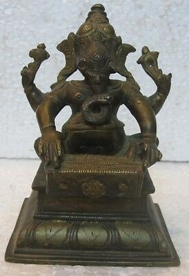 An old look solid brass sitting musician GANESHA hindu traditional statue