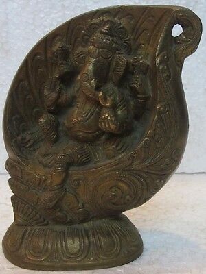 An old look solid brass elephant god GANESHA in counch hindu traditional statue