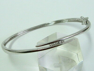 Pretty 9Ct White Gold Neat Ladies Crossover Bangle With Diamonds