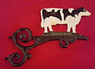 Awesome vintage cast iron painted cow sign bracket