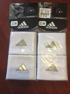 2 packets contains 2 White Adidas Wrist Bands