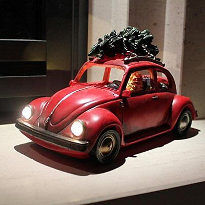 Santa Driving Vintage Beetle Car Lit with Christmas Tree on Roof