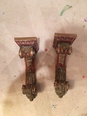 Pair of carved corbels painted