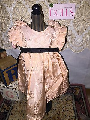 Beautiful vintage peach embossed dress with black trim for antique doll