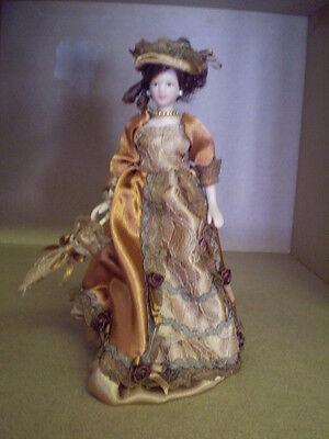 Dolls house figure 1/12th scale porcelein Lady in  Dress with parasol