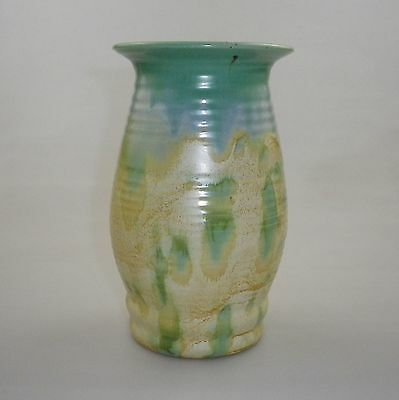 Early Remued Tall Vase With A Wide Open Mouth And A Small Flared Lip