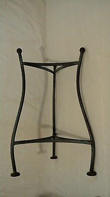 Multiple use metal stand with personality
