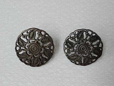 A decorative pair of art nouveau round metal furniture door handles