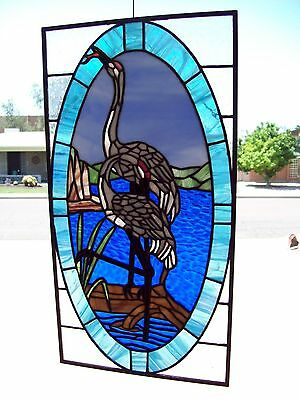 handmade multi colored stained glass egrets having lunch
