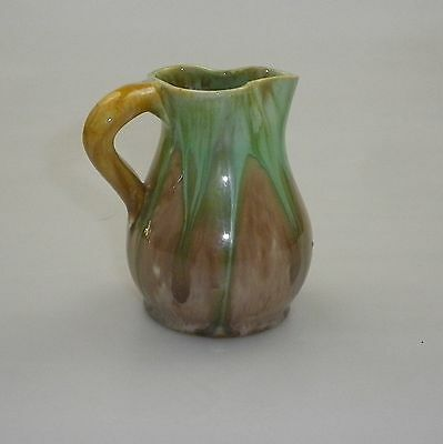 Early Series Remued Small Pot Bellied Shaped Jug