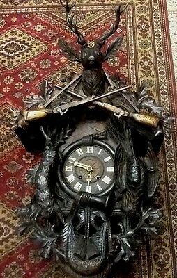 Hand Carved Black Forest Victorian Era Trumpeter Cuckoo Clock. Circa 1880.