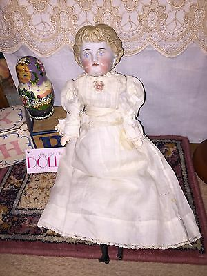 Antique China doll with deep carved blonde hair, replaced limbs/repaired plate