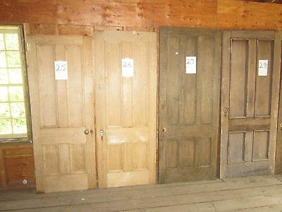 A large assortment of antique doors from a 19th century home that was demolished