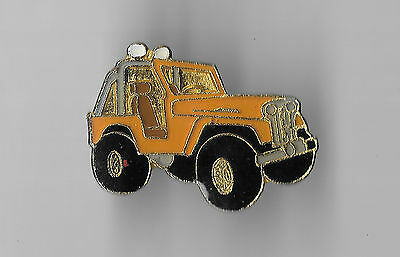 Vintage Yellow-Gold Jeep Tracker old enamel pin