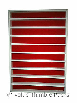 100 thimble display rack in white and red felt back