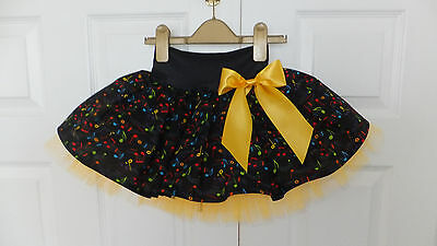 NEW HANDMADE CHILDS COLOURED MUSICAL NOTES TUTU SKIRT DANCE PARTY 6 - 8 yrs