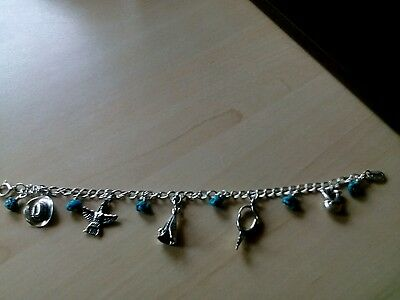 South Western Silver and Turquoise Navajo charm bracelet.