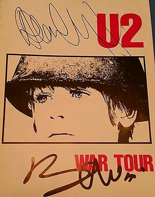 u2 -signed war tour programme  from 1983 ...bono n adam ..REAL.AND GENIUNE