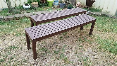 pair of brown 3 seater timber benches