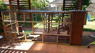 3 stories chicken coop with nibbles waterer and cups