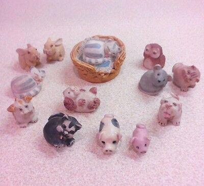 A collection of 13 Miniature animals